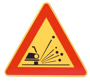 TRIANGLE – DANGER: UNSTABLE MATERIAL ON ROAD SURFACE